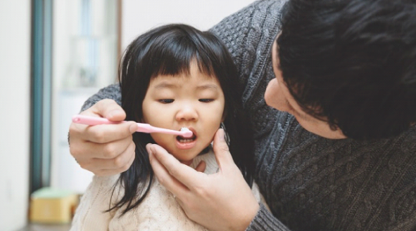 HOW TO MANAGE DENTAL CARIES IN INFANTS AND CHILDREN